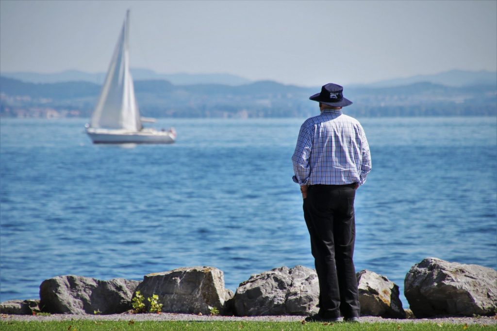 man looking out at a boat
